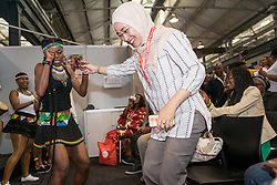 Anggia Ermarini, a Muslim activist from Indonesia, gets a lesson in African dancing in the Interfaith Networking Zone on July 20 at the 2016 International AIDS Conference in Durban, South Africa. Ermarini is secretary general of INTERNA and secretary of Nahdatul Ulama in Indonesia. The Interfaith Networking Zone is sponsored by the Ecumenical Advocacy Alliance of the WOrld Council of Churches.