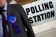 A conservative Teller makes a call outside St Peter's Primary School, Ebury Street, Belgravia that serves as a temporary Polling station for voters on Britain's general election day. The job of the teller is to record the election numbers of those about to vote, making sure that their political colleagues don't drop more literature in to that address, now that the occupants have voted.