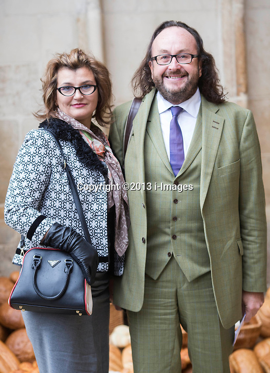Harvest for British Food Fortnight Service. Westminster Abbey, London, United Kingdom. Wednesday, 16th October 2013. Picture by i-Images<br /> <br /> Hairy biker David Myers and his wife Liliana arrive for the service.