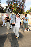 Israel, Tel Aviv, Neve Shaanan neighbourhood A new Torah is brought into the synagogue while the onlookers celebrate the event with dances and songs