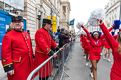 © Licensed to London News Pictures. 01/01/2018. London, UK. Two Chelsea Pensioners watch as Varsity Cheerleaders take part in the New Year's Day Parade in Central London. Photo credit: Rob Pinney/LNP