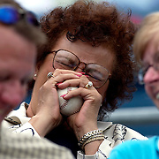 "Syracuse, NY / 2004 - Helen Brown of Liverpool laughs and squeezes the foul ball she just caught at the Syracuse Skychiefs (Toronto Blue Jays AAA affiliate) baseball game. ""It just fell into my lap,"" she said. Photo by Mike Roy / For The Syracuse Post-Standard"