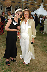Left to right, LADY IRVINE and LADY FALCONER OF THOROTON at the annual House of Lords v House of Commons tug of war match in aid of  of  Macmillan Cancer Relief on 21st June 2005.  A drinks reception was held in College Gardens followd by the tug of war on Victoria Tower Gardens, London.                                 <br />
