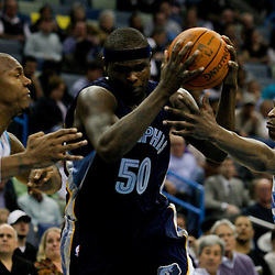 Jan 20, 2010; New Orleans, LA, USA; Memphis Grizzlies forward Zach Randolph (50) drives between New Orleans Hornets forward David West (left)and guard Devin Brown (right) during the first half at the New Orleans Arena. Mandatory Credit: Derick E. Hingle-US PRESSWIRE