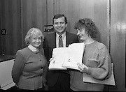 Presentation Of Donnelly Visas.  (R71)..1988..19.01.1988..01.19.1988..19th January 1988..As part of his interest in Ireland Congressman Brian Donnelly promoted a visa scheme to easily allow Irish people entry into America. Known now as the Donnelly Visas,Congressman Donnelly came to The American Embassy in Dublin to present the new visas to those where lucky enough in the first draw to obtain the visas...Picture shows Congressman Donnelly presenting the new visa to  Mrs Veronica Stack,Killarney,Co Kerry, for her and her husband Tom in the American Embassy in Dublin,Ambassador Heckler is also included in the picture.