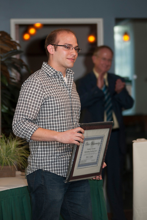 Alex Lunka gives thanks to those who helped him receive a 2013 Graduate Associate Outstanding Teaching Award during the ceremony held in the Faculty Commons on the third floor of Alden Library, Thursday 18, 2013.