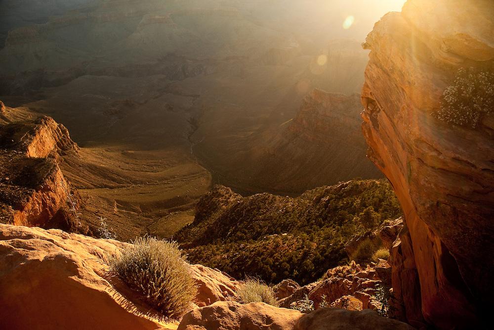 Sun glancing over the Grand Canyon Rim