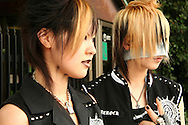 "Harajuku Goths.  A wide variety of ""costume play"" getups are shown here: goths, cartoon characters from Japanese manga, anime,  the sweet-and-innocent frilly look or combinations in between (goth lolly)  Every Sunday, these cosplay characters converge on Harajuku, Tokyo's fashion quarter. Most casual observers say that cosplay is a reaction to the rigid rules of Japanese society. But since so many cosplay girls congregate in Harajuku and Aoyama - Tokyo headquarters of Fendi, Hanae Mori and Issey Miyake, others consider it is a reaction to high fashion. Whatever the cause, cosplay aficionados put a tremendous amount of effort into their costumes every Sunday. One wonders what they wear on Monday morning..."