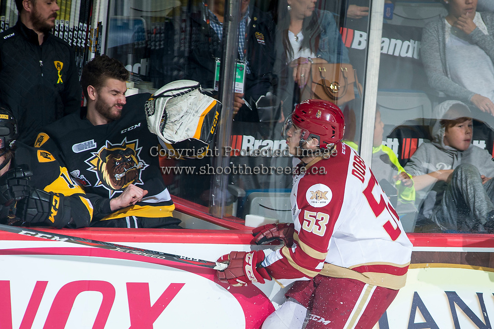 REGINA, SK - MAY 22: Noah Dobson #53 of Acadie-Bathurst Titan skates into the boards of the Hamilton Bulldogs' bench at Brandt Centre - Evraz Place on May 22, 2018 in Regina, Canada. (Photo by Marissa Baecker/Getty Images)