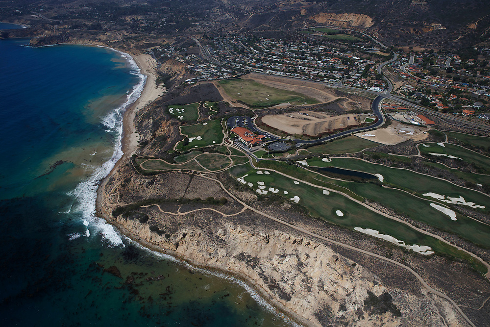 Trump National Golf Club, Los Angeles stands next to the Pacific Ocean in this aerial photograph taken during the historic drought over Rancho Palos Verdes, California, U.S., on Monday, August 31, 2015. Owned by The Trump Organization, the course was formerly known as Ocean Trails Golf Club, an 18-hole course designed by Pete Dye, which was about to open when a landslide occurred. Donald Trump bought the property known for it's views of the Pacific Ocean in 2002. © 2015 Patrick T. Fallon