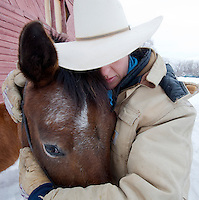 Jeannette McGrath hugs her horse, Apache, before taking a ride recently in Victor, Idaho.