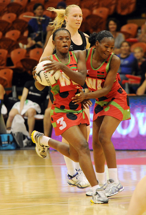 Malawis' Melenia Gideon, left, clashes with team mate Caroline Mtukule against New Zealand in the International Netball test at Pettigrew Green Arena, Napier, New Zealand, Sunday, October 27, 2013. Credit:SNPA / Ross Setford