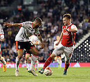 Lee Frecklington taking on Ashley Richards during the Sky Bet Championship match between Fulham and Rotherham United at Craven Cottage, London, England on 15 April 2015. Photo by Matthew Redman.