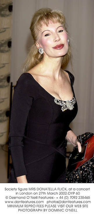 Society figure MRS DONATELLA FLICK, at a concert in London on 27th March 2002.	OYP 60