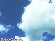 A bluer sky with a white puffy cloud.