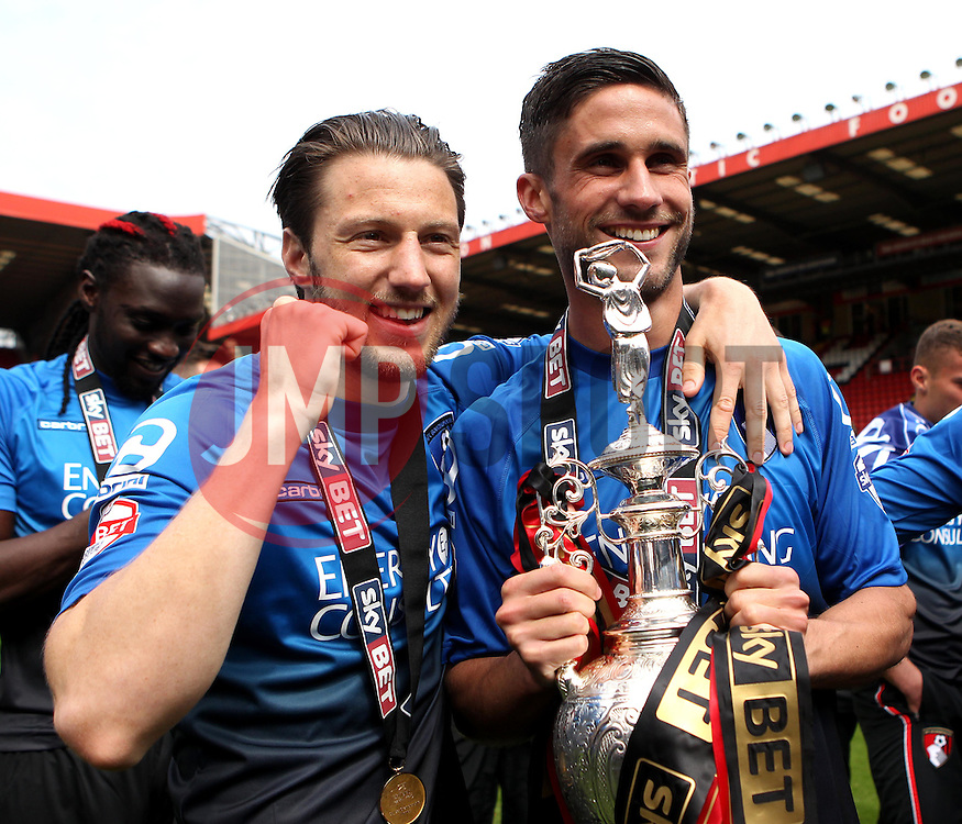 Bournemouth's Harry Arter and Bournemouth's Andrew Surman celebrate with the Sky Bet Championship Trophy - Photo mandatory by-line: Robbie Stephenson/JMP - Mobile: 07966 386802 - 02/05/2015 - SPORT - Football - Charlton - The Valley - Charlton v AFC Bournemouth - Sky Bet Championsip