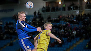 Jordan Burrow (Halifax) wins another header but this time over the bar in the final few moments of the game, trying to get the winner during the Conference Premier League match between FC Halifax Town and Guiseley at the Shay, Halifax, United Kingdom on 5 December 2015. Photo by Mark P Doherty.