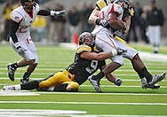 October 03, 2009: Iowa cornerback Tyler Sash (9) pulls down Arkansas State running back Don Jones (38) during the first half of the Iowa Hawkeyes' 24-21 win over the Arkansas State Red Wolves at Kinnick Stadium in Iowa City, Iowa on October 03, 2009.
