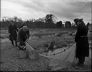 11/03/1959<br /> 03/11/1959<br /> 11 March 1959<br /> Fanure Fish Farm, Roscrea, Co. Tipperary. The farm was set up in the early 1960's to farm trout. Image shows workers collectiong Rainbow Trout from one of the outdoor ponds on the farm.