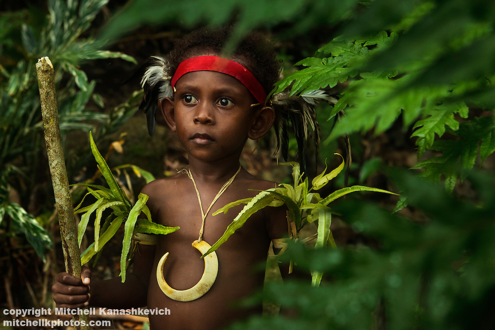 Young, traditional Ni Vanuatu boy with a pig tusk. The pig tusk is a sign of a chief, the boy is a son of a chief. Near village of Labo, South West Bay, Malekula