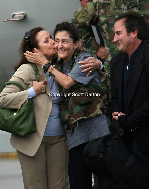 Ingrid Betancourt, who was help captive by FARC rebels for over 6 years, is kissed by her mother upon her arrival to Bogotá after being rescued in a Colombian military operation on July 2, 2008. (Photo/Scott Dalton)