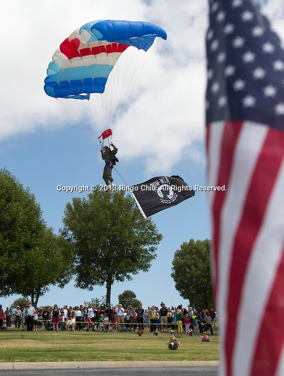 A member of FST skydiving team performs during the Memorial Day Observance Monday, May, 27, 2013, at Green Hills Memorial Park in Rancho Palos Verdes, California.(Photo by Ringo Chiu/PHOTOFORMULA.com).