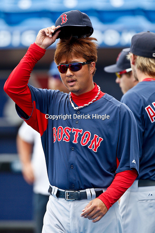 March 6, 2011; Port St. Lucie, FL, USA; Boston Red Sox relief pitcher Hideki Okajima (37) before a spring training exhibition game against the New York Mets at Digital Domain Park.  Mandatory Credit: Derick E. Hingle