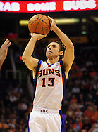 Nov. 3 2010; Phoenix, AZ, USA; Phoenix Suns guard Steve Nash (13) puts up a basket during the first half against the San Antonio Spurs at the US Airways Center. The Spurs defeated the Suns 112-110.   Mandatory Credit: Jennifer Stewart-US PRESSWIRE.