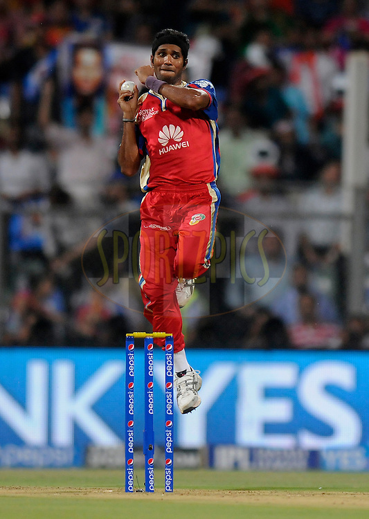 Ashoke Dinda of the Royal Challengers Bangalore bowls during match 27 of the Pepsi Indian Premier League Season 2014 between the Mumbai Indians and the Royal Challengers Bangalore held at the Wankhede Cricket Stadium, Mumbai, India on the 6th May  2014<br /> <br /> Photo by Pal Pillai / IPL / SPORTZPICS<br /> <br /> <br /> <br /> Image use subject to terms and conditions which can be found here:  http://sportzpics.photoshelter.com/gallery/Pepsi-IPL-Image-terms-and-conditions/G00004VW1IVJ.gB0/C0000TScjhBM6ikg