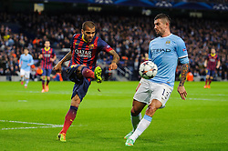 Barcelona Defender Daniel Alves (BRA) clears past Man City Defender Aleksandar Kolarov (SRB) - Photo mandatory by-line: Rogan Thomson/JMP - Tel: 07966 386802 - 18/02/2014 - SPORT - FOOTBALL - Etihad Stadium, Manchester - Manchester City v Barcelona - UEFA Champions League, Round of 16, First leg.