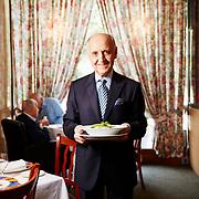 Giorgio Meriggi holds a pasta dish, Stresa, Manhasset, Sept. 25, 2015.<br /> By Yvonne Albinowski