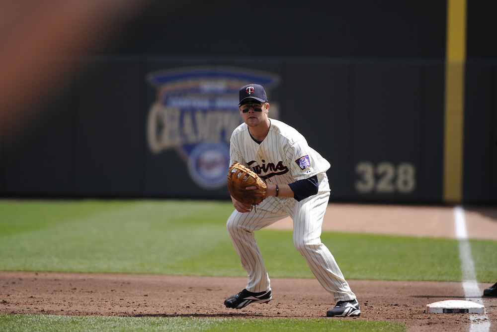 MINNEAPOLIS - APRIL 24:  Justin Morneau #33 of the Minnesota Twins fields against the Cleveland Indians on April 24, 2011 at Target Field in Minneapolis, Minnesota.  The Twins defeated the Indians 4-3.  (Photo by Ron Vesely)  Subject:  Justin Morneau