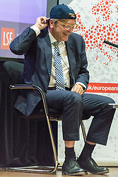 © Licensed to London News Pictures. 28/09/2017. London, UK. Guy Verhofstadt is presented with a baseball cap to wear after making a speech titled 'The Future of Europe Post-Brexit' at the London School of Economics event. Mr Verhofstadt argues for a Europe that is united against challenges nation-states can no longer deal with on their own: from migration to defence to the tackling of the economic crisis. Brexit is the perfect opportunity to deliver that stronger and more democratic Europe. Photo credit: Ray Tang/LNP