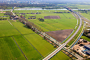 Nederland, Gelderland - Overijssel, Hattem, 01-05-2013; toerit naar de IJsselbrug, spoorbrug bij Hattem voor de Hanzelijn. <br /> De rode spoorbrug De Hanzeboog over de IJssel, is ontworpen door  Quist Wintermans Architecten. Zwolle  en de IJssel in de achtergrond.<br /> The red railway bridge Hanzeboog (Hanseatic arch) over the IJssel near Zwolle, has been designed by Quist Wintermans Architects.<br /> luchtfoto (toeslag op standard tarieven);<br /> aerial photo (additional fee required);<br /> copyright foto/photo Siebe Swart