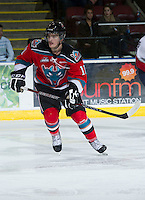 KELOWNA, CANADA - NOVEMBER 28:   Carter Rigby #11 of the Kelowna Rockets skates on the ice against the Tri City Americans at the Kelowna Rockets on November 28, 2012 at Prospera Place in Kelowna, British Columbia, Canada (Photo by Marissa Baecker/Shoot the Breeze) *** Local Caption ***