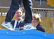 SOUTH BERMONDSEY, LONDON:  (L-R) Ed Balls and Yvette Cooper pictured through the legs of Alfie Warren aged 9Ed Balls, Labour Leadership candidate joins shadow housing minister John Healey and  shadow work and pensions secretary Yvette Cooper  during a visit to a housing development, The Falcon Works development, in central London on 31 August 2010. STEPHEN SIMPSON..