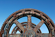 rusty cogwheel against an amazing blue sky backdrop at Wynyard Quarter, Auckland Viaduct, New Zealand