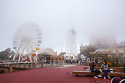 Clouds envelope the amusement park ferris wheel at Tibidabo, Barcelona.