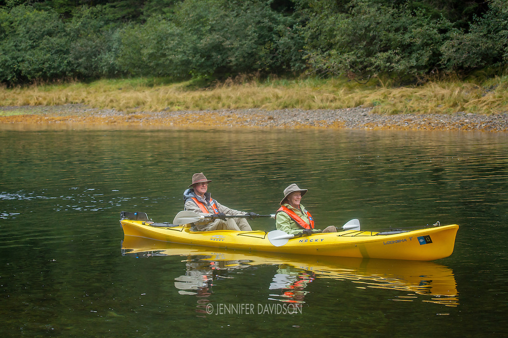 Guests from the National Geographic Sea Lion kayak in Pavlof Harbor, Alaska.