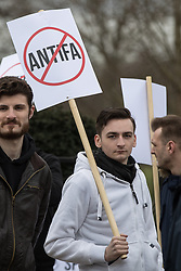 "© Licensed to London News Pictures. 11/03/2018. London, UK. An alt-right supporter with an anti antifa placard .Alt right group Generation Identity and other far-right groups hold a demonstration at Speakers' Corner in Hyde Park , opposed by antifascists . Generation Identity supporters Martin Sellner and Brittany Pettibone were due to speak at the demo but were arrested and detained by police when they arrived in the UK , also forcing them to cancel an appearance at a UKIP "" Young Independence "" youth event , which in turn was reportedly cancelled amid security concerns . Photo credit: Joel Goodman/LNP"