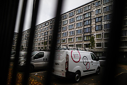 © Licensed to London News Pictures . 11/10/2018. Salford , UK . GV of temporary cladding stripped back and Together Housing vans . Recently installed cladding at several council-owned tower blocks in Salford has been identified as having similar dangerous properties to that which was installed on the Grenfell Tower in London . Residents have been waiting months for clarification on what action will be taken to make their homes safe . Photo credit : Joel Goodman/LNP
