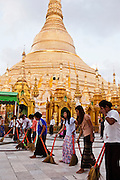 Sweeping the plaza surrounding the Shwedagon Pagoda, Yangon, Myanmar.