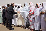 British Labour peer, Lord Ahmed of Rotherham shakes hands with Darfurian women on the tarmac of Al Fashir airport, Sudan. Nazir, Baron Ahmed (born 1958) is a member of the House of Lords, having become the United Kingdom's first Muslim life peer in 1998 and is in this war-torn province of Sudan to attend the first-ever international Conference on Womens' Challenge in Darfur, hosted by the govenor in his own compound.