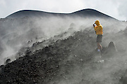 The crater caused by the 2002 eruption of Mount Etna, Sicily's 3.350 m high active Vulcano, still emits sulfuric fumes.