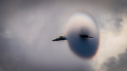 June 13, 2017 - Uss Carl Vinson, United States of America - A U.S. Navy F/A-18E Super Hornet fighter aircraft from the Strike Fighter Squadron 192 Golden Dragons creates a vapor cone as it breaks the sound barrier during operations over the Nimitz-class aircraft carrier USS Carl Vinson June 12, 2017 in the Pacific Ocean. (Credit Image: © Matthew Granito/Planet Pix via ZUMA Wire)