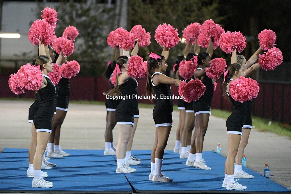 Ocoee cheerleaders perform during the second half of a high school football game against Edgewater Monday, Oct. 9, 2017, in Orlando, Fla. Edgewater won 44-29. (Photo by Phelan M. Ebenhack)