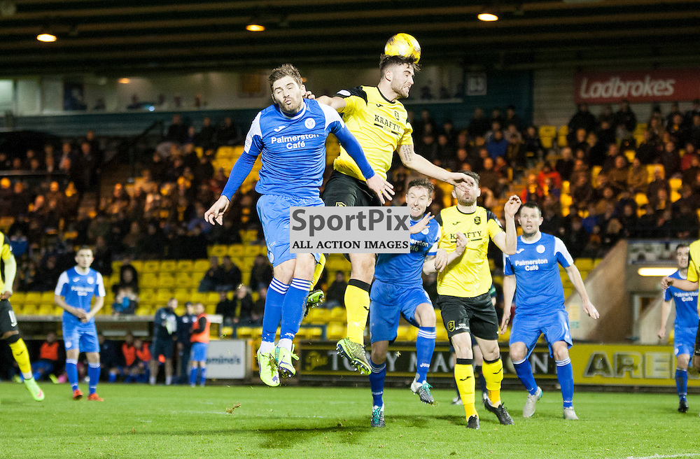 Livingston v Queen of the South, Scottish Championship, 2 January 2016, Kyle Hutton (Queen of the South, 16) is beaten to the ball by Morgyn Neill (Livingston, 15) during the Livingston v Queen of the South Scottish Championship match played at the Toni Macaroni Arena, © Chris Johnston | SportPix.org.uk