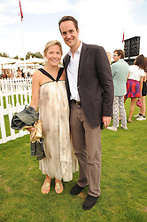 The HON.EDWARD TOLLEMACHE and his wife SOPHIE at the Cartier International Polo at Guards Polo Club, Windsor Great Park, Berkshire on 25th July 2010.
