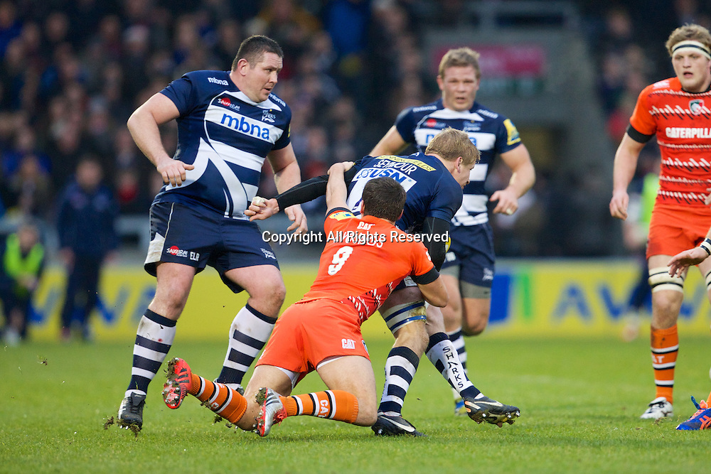 27.12.2014.  Sale, England.  Aviva Premiership. Sale Sharks versus Leicester Tigers. Leicester Tigers scrum-half Ben Youngs tackles Sale Sharks flanker David Seymour.
