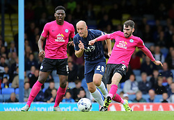 Michael Smith of Peterborough United passes the ball away from Southend United's Adam Barrett - Mandatory byline: Joe Dent/JMP - 07966386802 - 05/09/2015 - FOOTBALL - Roots Hall -Southend,England - Southend United v Peterborough United - Sky Bet League One